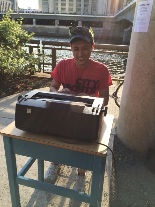 Millennial Youth writes analog letter with Selectric II, by the river's edge.