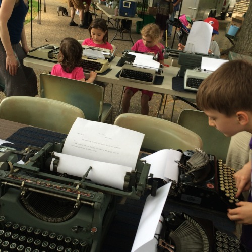 Young people encounter vintage typing machines...
